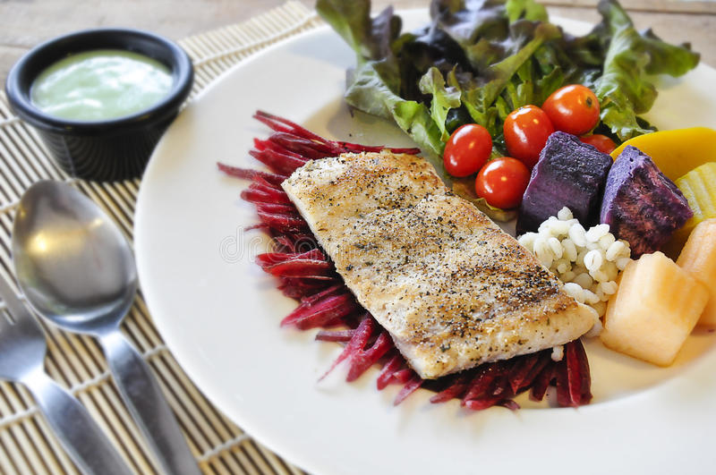 Sea bass Fish steak. On the wooden table royalty free stock photo