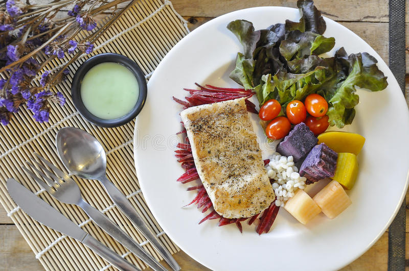 Sea bass Fish steak. On the wooden table stock images