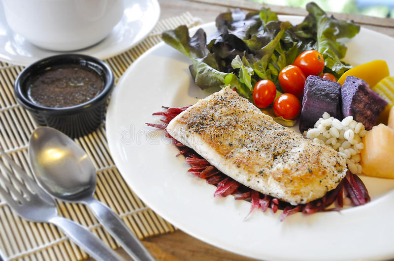 Sea bass Fish steak. On the wooden table stock image