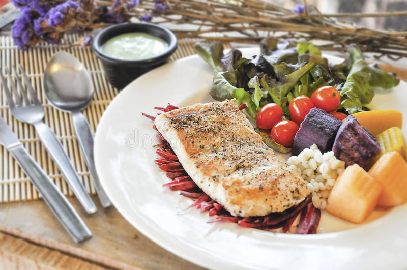 Sea bass Fish steak. On the wooden table stock photography