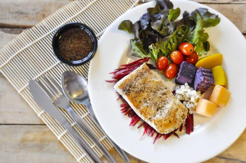 Sea bass Fish steak. On the wooden table stock photos