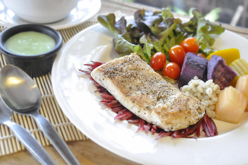 Sea bass Fish steak. On the wooden table stock photo