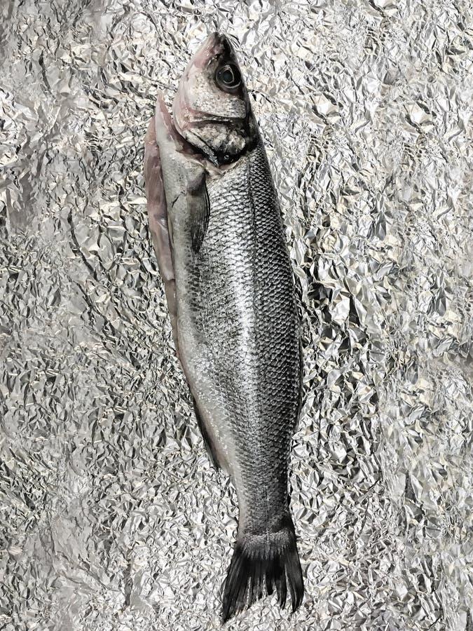 A sea bass. On a foil sheet stock photo