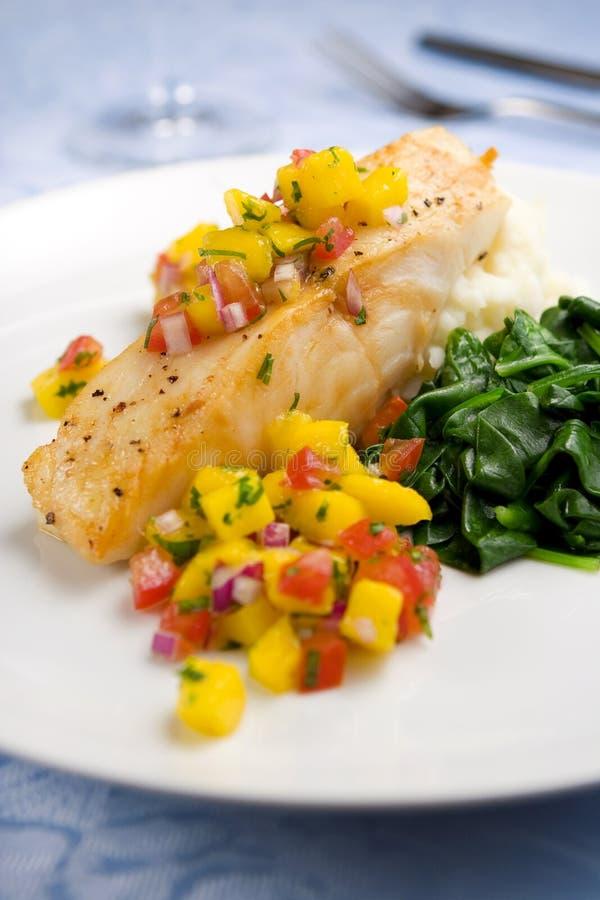 Sea bass with mango salsa stock image