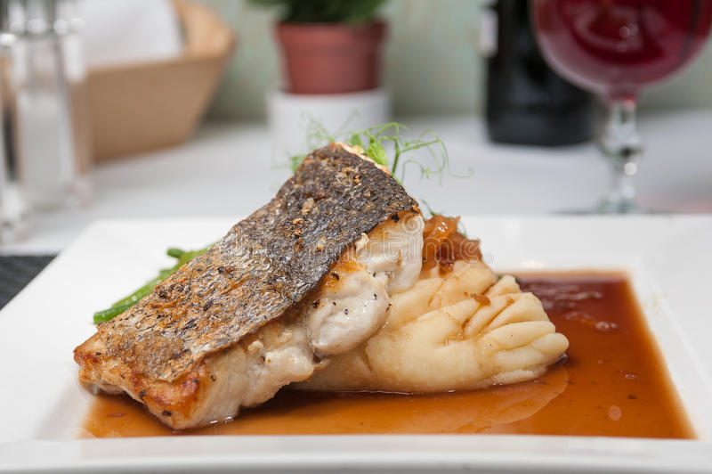 Sea Bass with mashed potato. Fillet of Sea Bass with mash potato and green beans royalty free stock photos