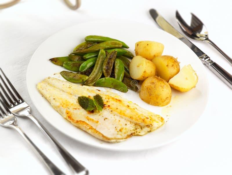 Sea Bass meal. A meal of Sea Bass potpto sugar snap peas for a healthy alternative stock photo
