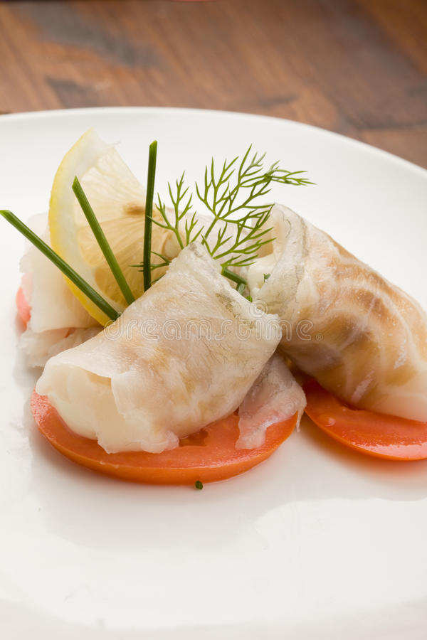 Sea Bass Rolls With Tomatoes Stock Images