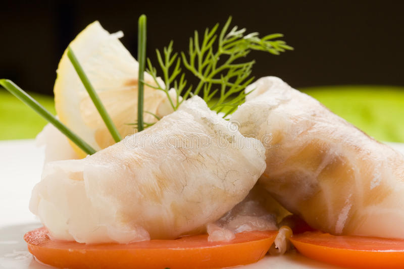 Sea Bass rolls with tomatoes royalty free stock image