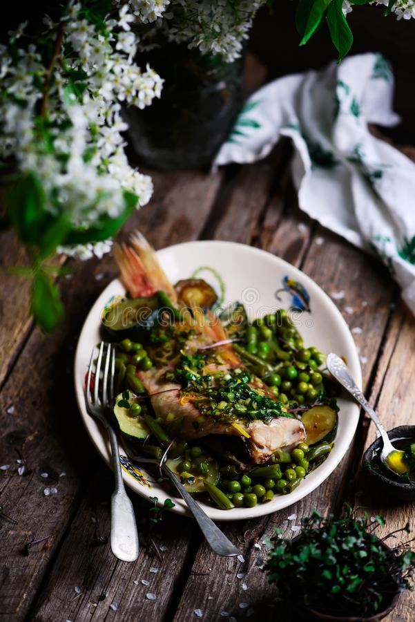 Sea Bass Stew with Green Vegetables.style rustic royalty free stock image