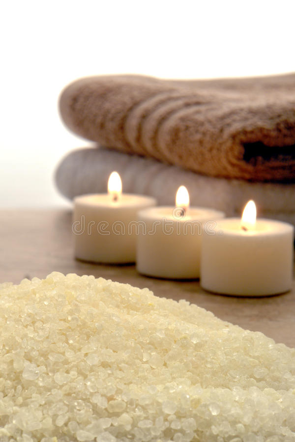 Sea Bath Salts and Burning Candles in a Spa stock image