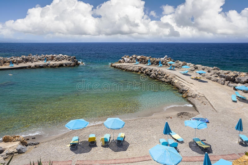 Sea bay and the beach of the village of Panormas. The island of Crete, Greece stock images