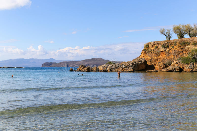 By the Sea. Bay with calm shallow water close to Agioi Apostoloi beach on Crete. There are some cliffs and only light surge of waves stock photo
