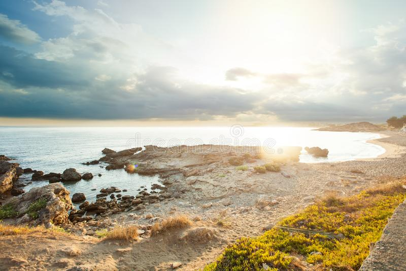 Sea beach with stownes and summer sky royalty free stock photo