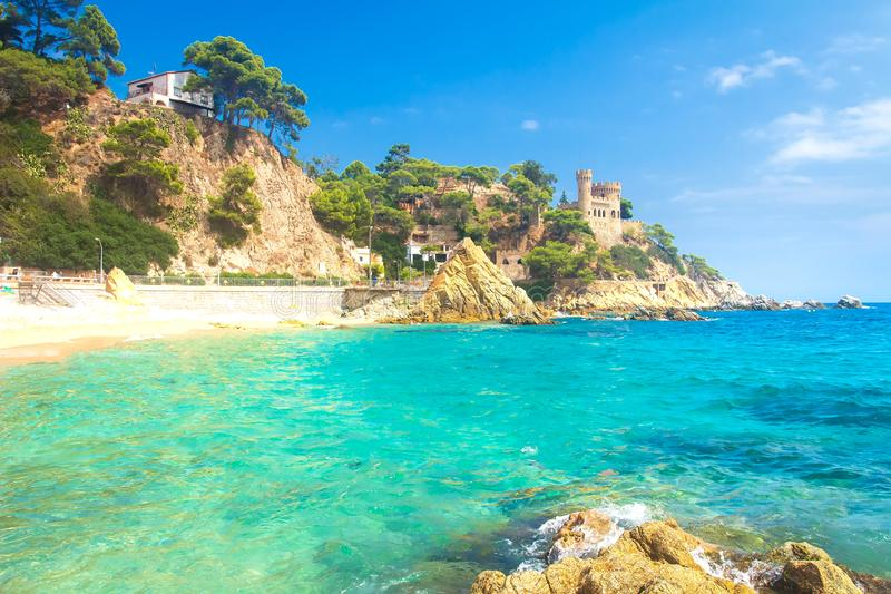 Sea beach on sunny bright day in Lloret de Mar, Costa Brava, Spain. Turquoise water in spanish sea coast. Summer vacation in Catalonia royalty free stock photos
