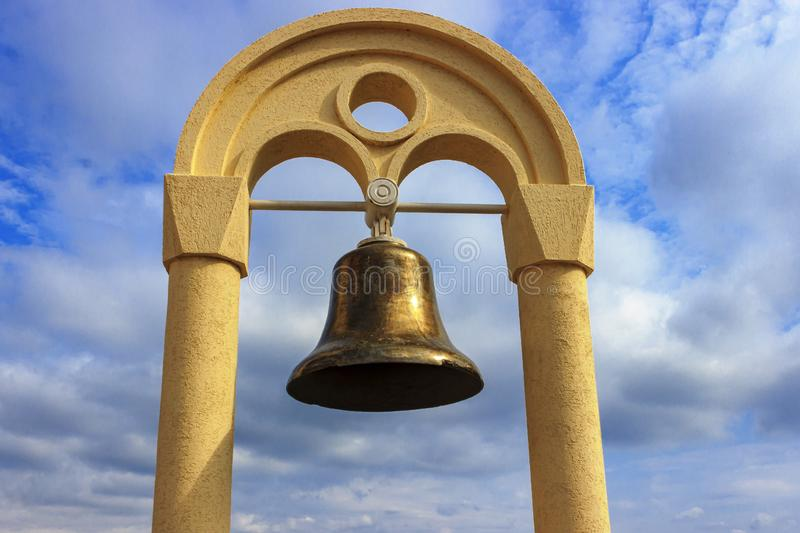 Sea bell against the blue sky with white clouds stock photos