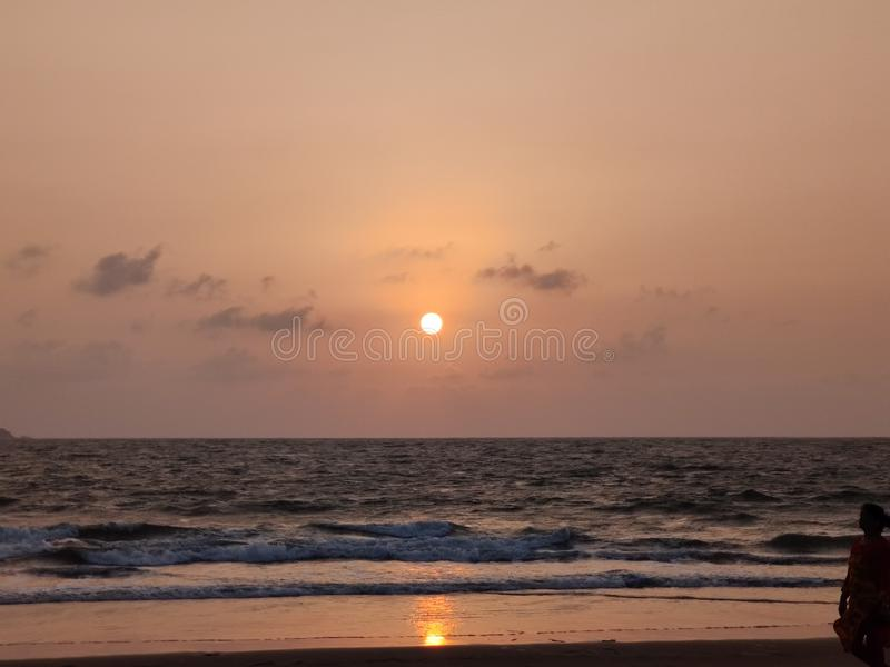 The sea beyond the sight. Ocean, infinity, water, salt, saltwater, sunrise, sunset, orange, clouds, view stock images