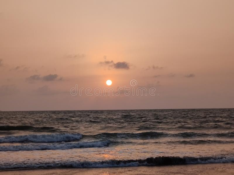 The sea beyond the sight. Ocean, infinity, water, salt, saltwater, sunrise, sunset, orange, clouds, view royalty free stock photo