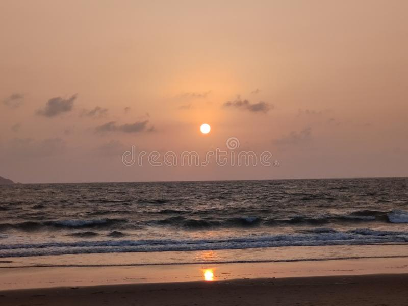 The sea beyond the sight. Ocean, infinity, water, salt, saltwater, sunrise, sunset, orange, clouds, view stock photography