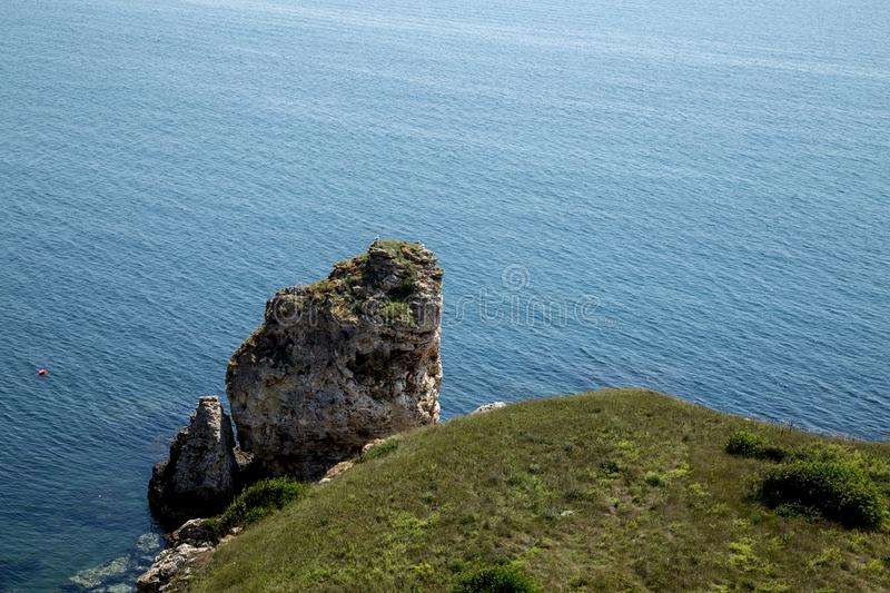 Bank of Black Sea. Seal, Bulgaria. Sea. Birds on the top of rock. At-sea there is a float of skin-diver stock images