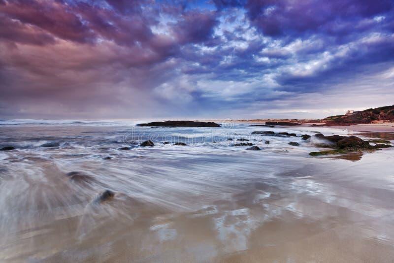Sea birubi pink wave sunrise royalty free stock images