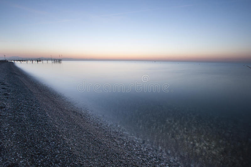 Sea and blue and pink sky stock photo