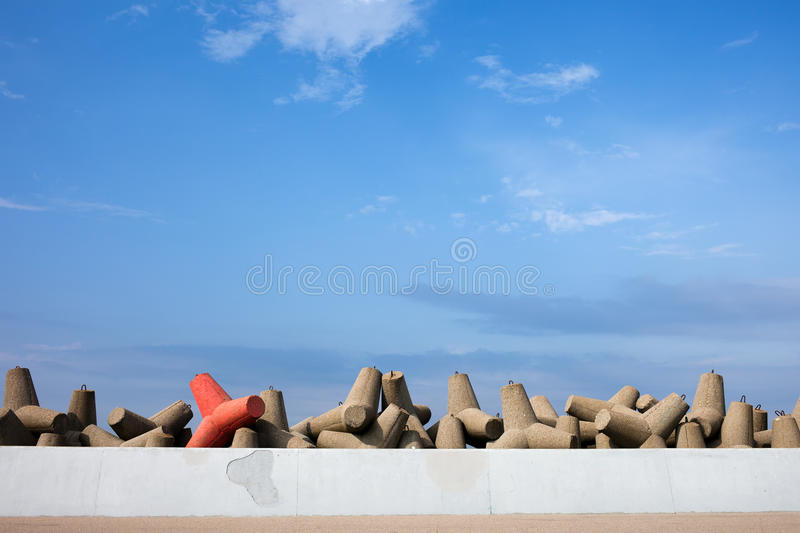 Sea Breakwater and Be Different Concept stock photo