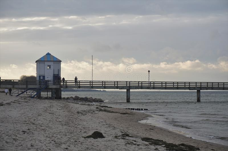 Baltic sea Lubmin with wooden watch tower. Sea bridge in baltic sea Lubmin with wooden watch tower sunset royalty free stock image