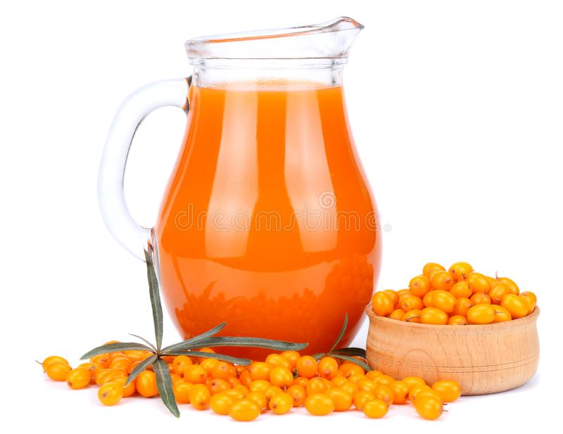 Sea buckthorn juice in glass isolated on white background royalty free stock photos