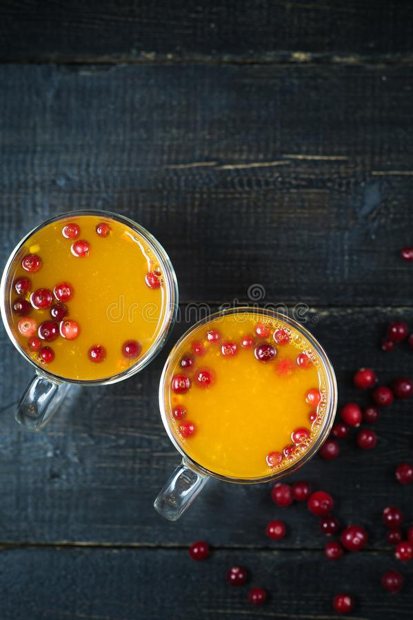Sea buckthorn tea in cups on black background royalty free stock photo