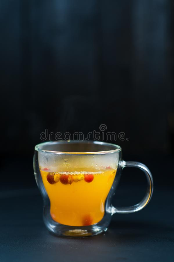 Sea buckthorn tea in cups on black background stock images