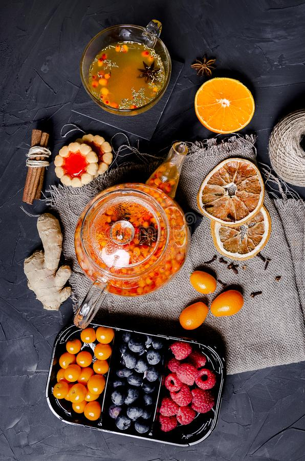 Sea buckthorn tea with ginger, berries and cinnamon royalty free stock images