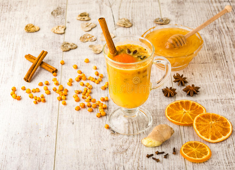Sea buckthorn tea with honey stock photo