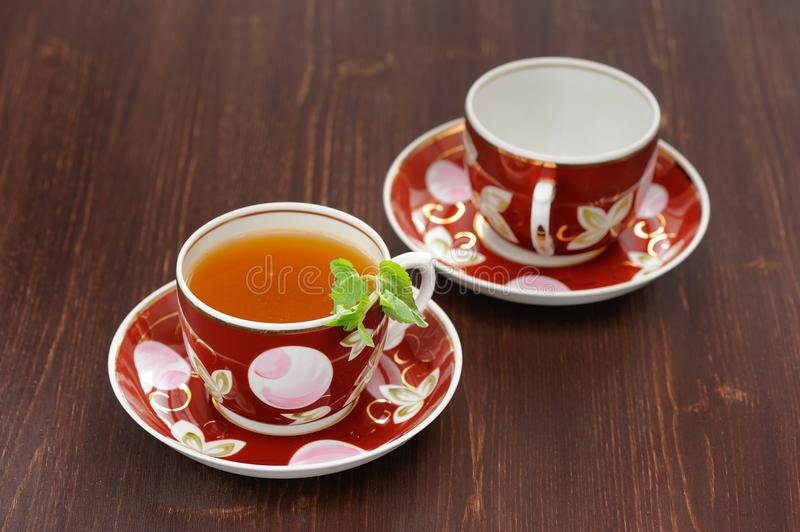 Sea-buckthorn tea with mint in red cups stock photography