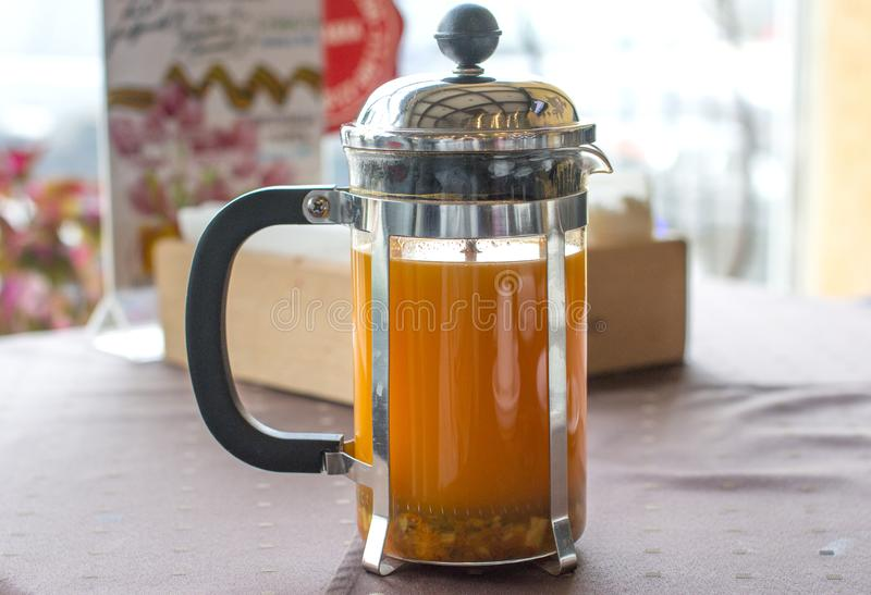 Sea buckthorn tea. A hot drink and a glass bottle of oil royalty free stock image