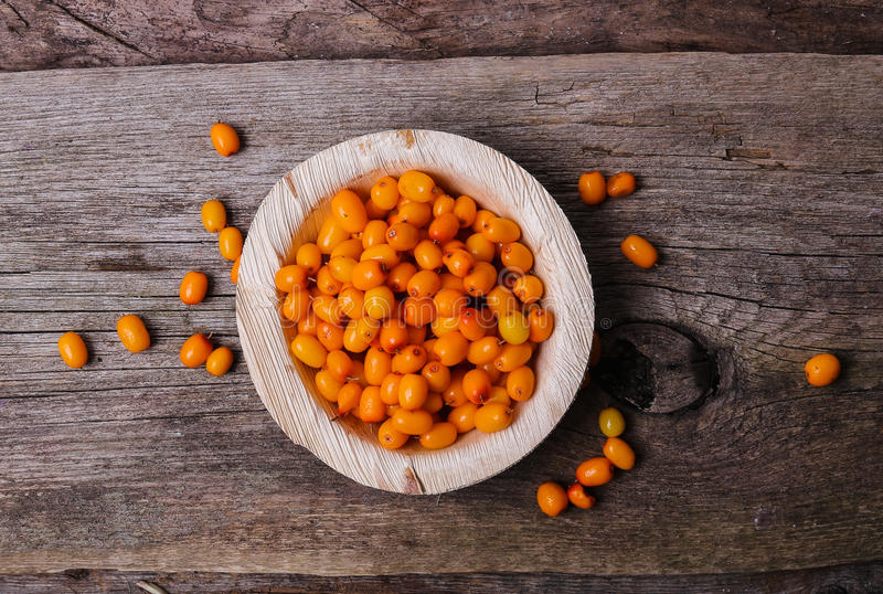Sea buckthorn. On the wooden table royalty free stock photo