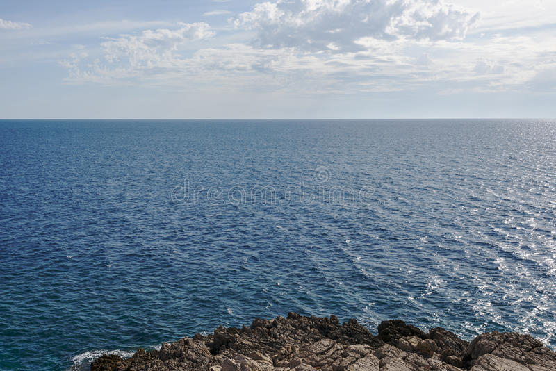 Sea calm surface and blue cloud sky. Horizon. Bay Gertsegnovska in Adriatic stock photos