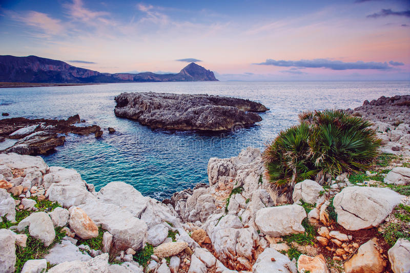 Sea and Cape Milazzo. Italy. Sea coast at sunset Cape Milazzo. Italy royalty free stock photo