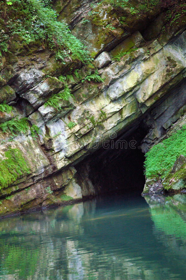 Sea cave entrance stock photography