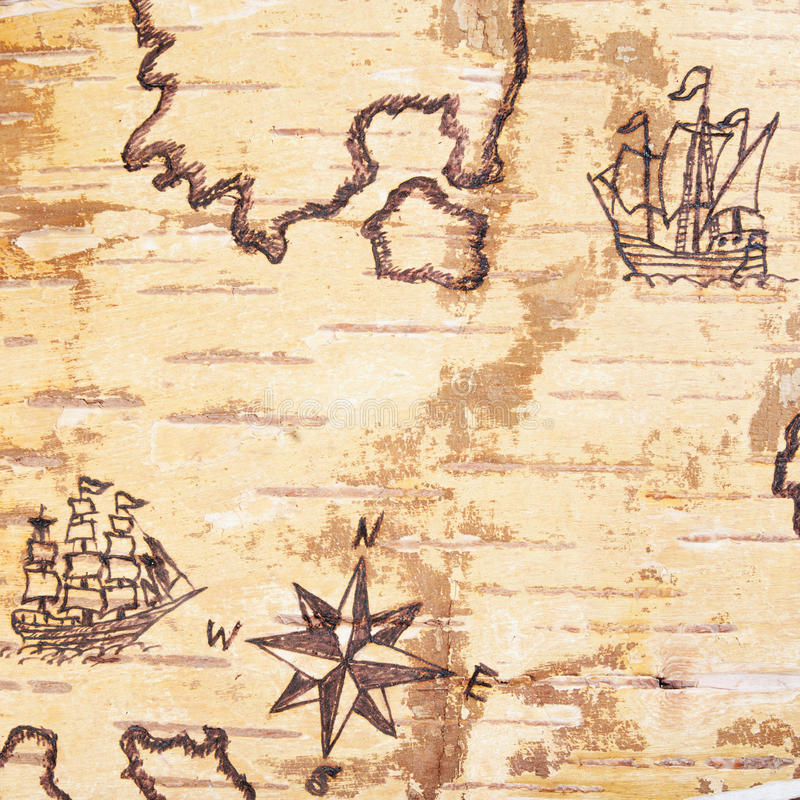 The sea chart. With ships on the order of olden time on birchbark royalty free illustration