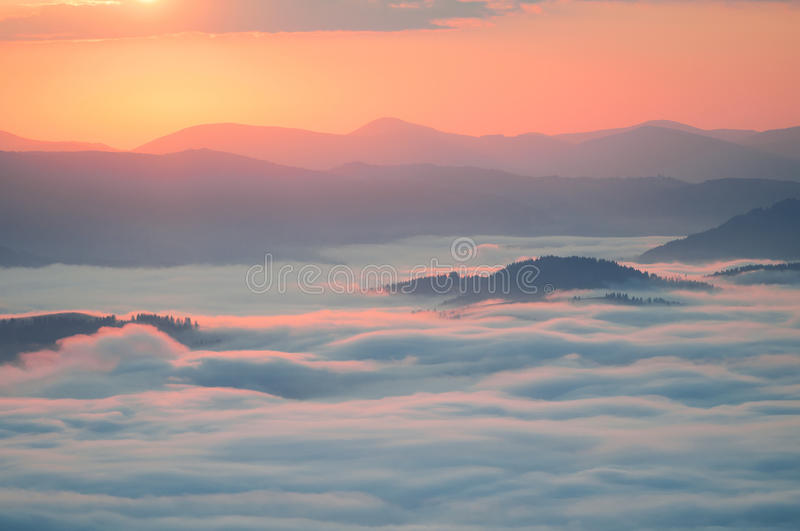 Sea of clouds in mountain at sunrise. Carpathians, the ridge Borzhava, Ukraine. royalty free stock image
