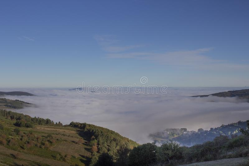 Sea of clouds on top of the mountain royalty free stock image