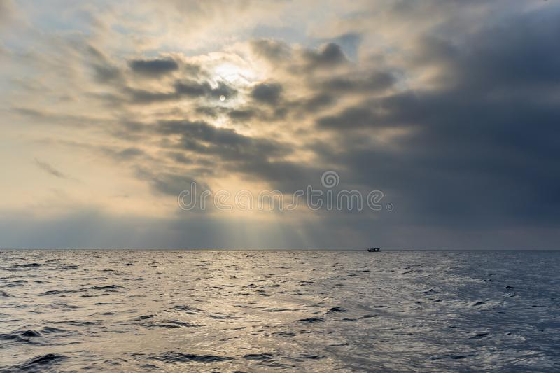The sea in cloudy and foggy weather. With floating boat royalty free stock images
