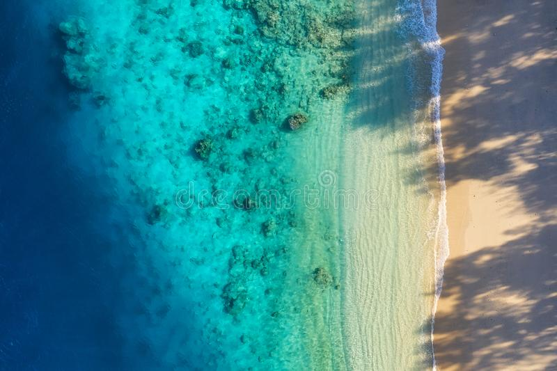 Sea coast as a background from top view. Turquoise water background from top view. Summer seascape from air. Bali island, Indonesi royalty free stock photography