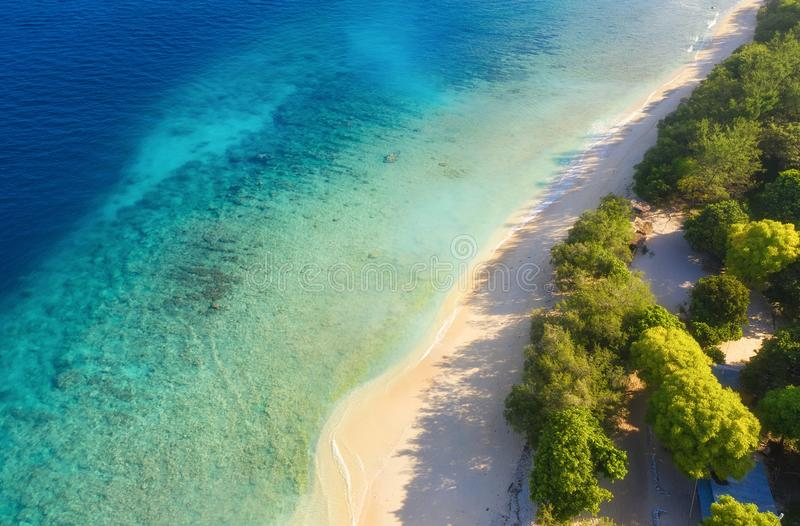Sea coast as a background from top view. Turquoise water background from top view. Summer seascape from air. Bali island, Indonesi stock images