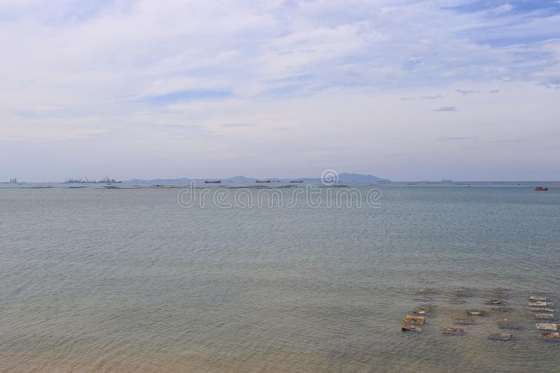 Sea coast and blue sky on daytime. stock photo
