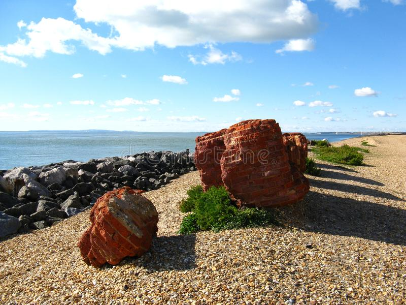 Brick breakwaters on the English coast stock images