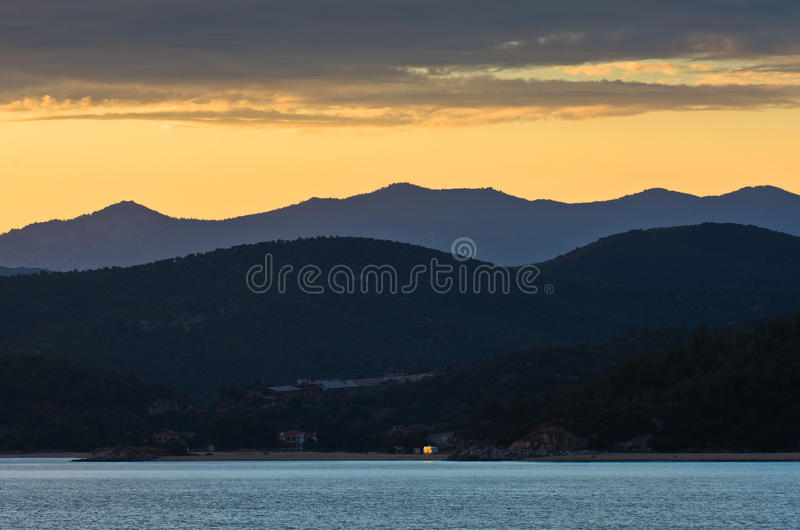 download sea coast and mountains after sunset west coast of sithonia greece stock photo