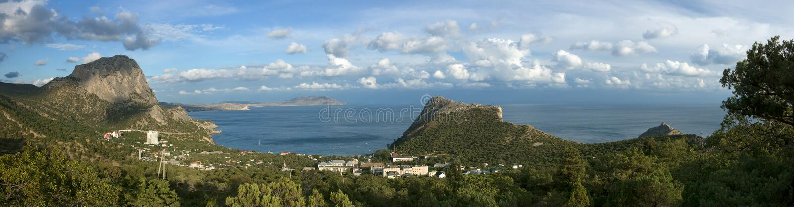 Download Sea Coast With Mountains And Town Stock Photo - Image: 24980044
