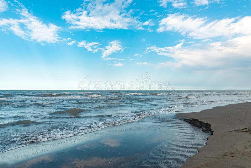 Sea coast, summer cloudy weather stock image