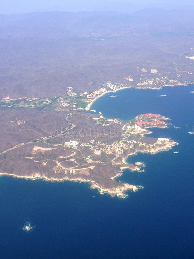 Aerial view of Huatulco. Sea, coast, travel, tourism, vacation, Oaxaca, Mexico, Pacific Ocean, tropical, flag, water royalty free stock images